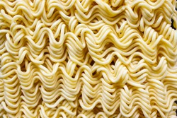 Close up of Instant raw noodles.Instant noodles texture, Dried instant noodles. raw noodles