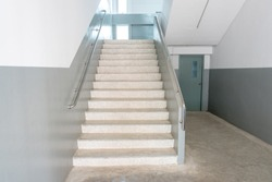 Close up of interior staircase in school. Empty architecture of stair steps design.