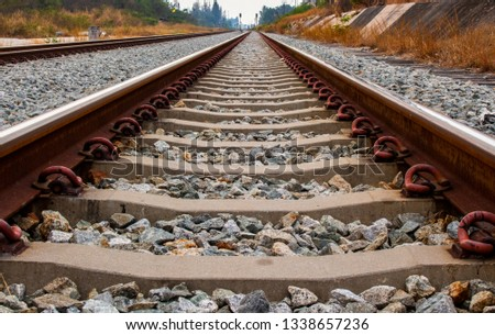 Close up of iron railroad and concrete railroad sleeper or railroad tie. #1338657236