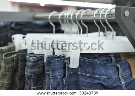 Close up of jeans on a rack