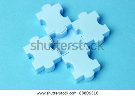Close up of jigsaw puzzle blocks arranged on blue background