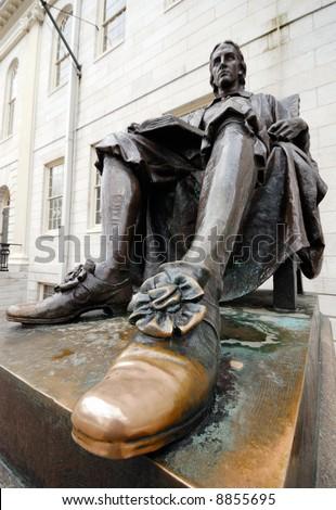 Close-up of John Harvard statue's polished shoe. Tourists, and aspiring students from all over the world, keep rubbing it for good luck.