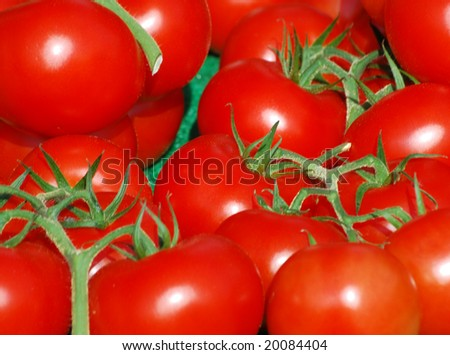 Close-up of juicy tomatoes on market stall