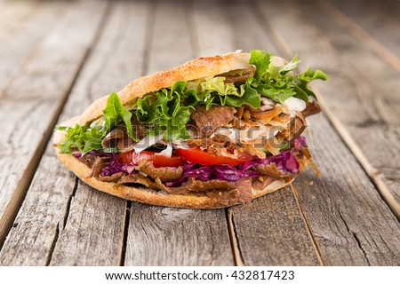 close up of kebab sandwich on...