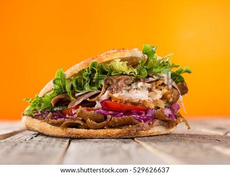 close up of kebab sandwich on...
