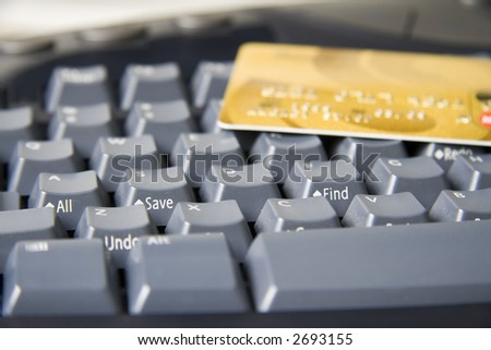 """Close-up of keyboard with """"Find"""" and """"Save"""" keys in focus and a credit card on top."""