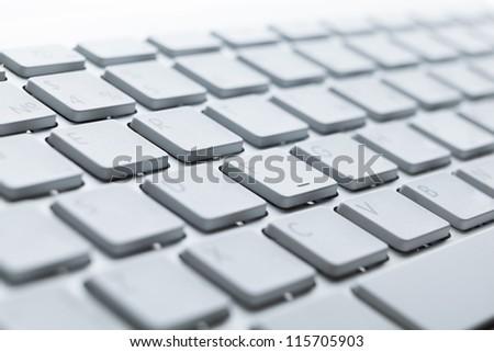 Close up of keys of light laptop keyboard