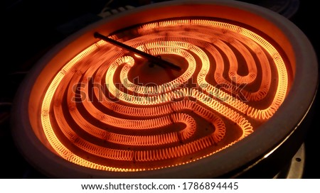 close up of kitchen stove burner inside electrical resistance thermostat cooking food technology wire cables fire electricity heat power ac ceramic induction hob repair technician recipe chef
