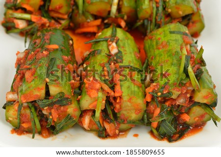 Close up of Korean food Oisobag-i(stuffed cucumber pickles) with multiple seasonings in a white dish, South Korea Stock photo ©