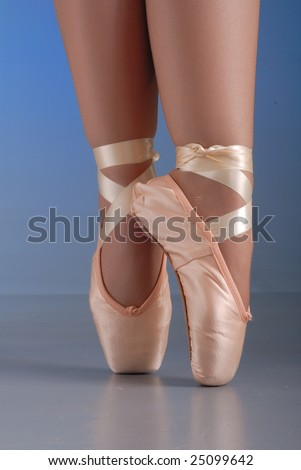 close up of lady ballet dancer legs and feet, standing on her toes