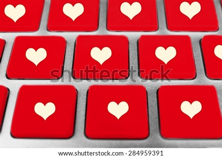 Close up of laptop keyboard with hearts icons #284959391