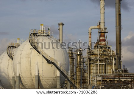 Close-up of large gas tanks and a petrochemical plant
