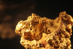 Close up of large Gold Nugget black background