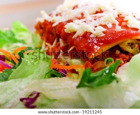 Close up of Lasagna with salad - vivid colors
