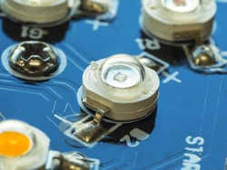 close up of laser diode, high power LED installed on blue circuit board