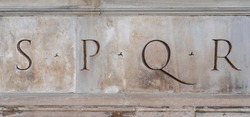Close up of Latin inscription in a stone statue in Rome. SPQR is an initialism from a Latin phrase, Senatus Populusque Romanus, referring to the government of the ancient Roman Republic
