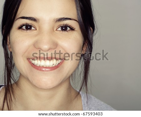 Close up of laughing happy smiling young woman