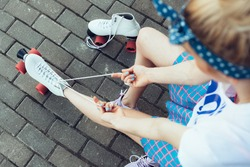 Close-up Of Legs Wearing Roller Skating Shoe, Outdoors lifestyle portrait