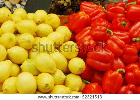 close up of lemons and red peppers on market stand