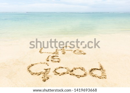 Close-up Of Life Is Good Word Written On The Sand At Idyllic Beach #1419693668