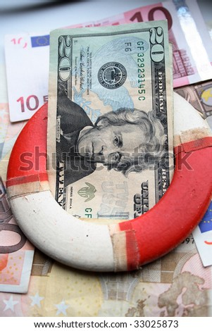 Close up of life ring with banknotes