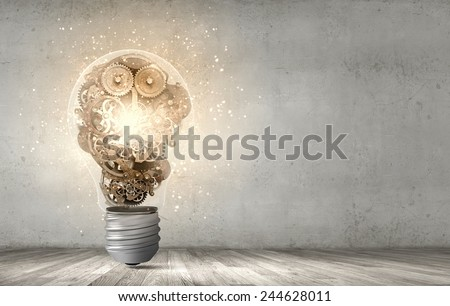 Close up of light bulb and gears mechanism