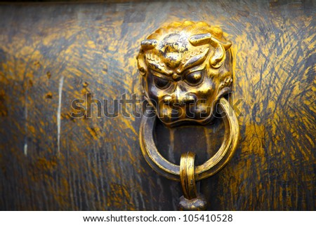 Close-up of lion head on a bronze pot found at Forbidden City, Beijing, China