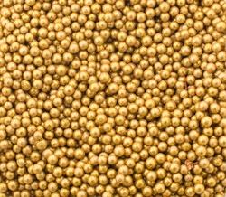 Close up of little golden balls