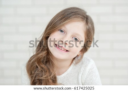 Close up of little 7 years old girl smiling #617425025