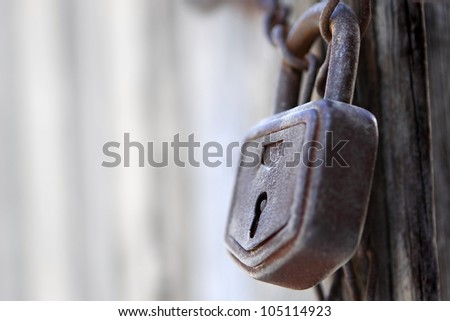 Close-up of lock and chains on old door