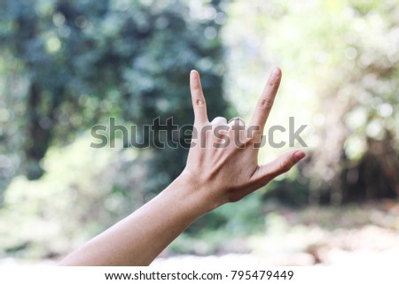 """Close-up of Love Hand Sign , Hand with """"I LOVE YOU """" Sing  on nature green bokeh sun light and blurred leaf abstract background.  Vintage tone color.  Valentine concep #795479449"""