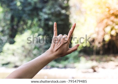 """Close-up of Love Hand Sign , Hand with """"I LOVE YOU """" Sing  on nature green bokeh sun light and blurred leaf abstract background.  Vintage tone color.  Valentine concep #795479485"""