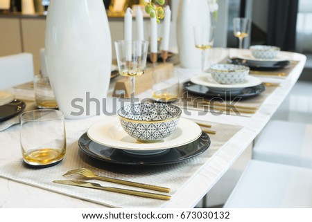 Close up of luxury gold plate setting on table