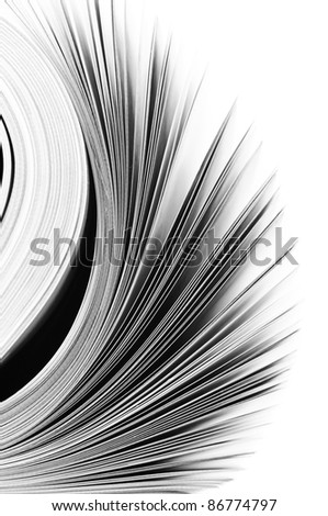 Close-up of magazine pages on white background. B&W image. Shallow DOF, focus on edges.