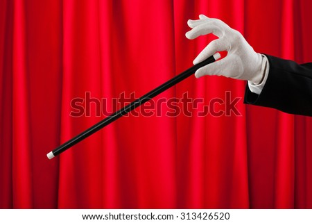 Close-up Of Magician Hands With The Magic Wand Showing Magic