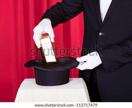 Close-up Of Magician Removing Bullion From Hat