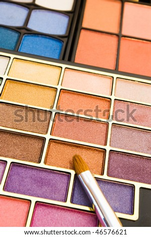 close-up of make-up colors and brush