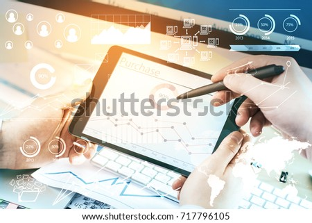 Close up of male and female hands using tablet with digital business report hologram. Teamwork and infograph concept  #717796105
