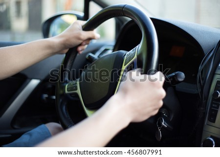 close up of male driver hands holding steering wheel #456807991