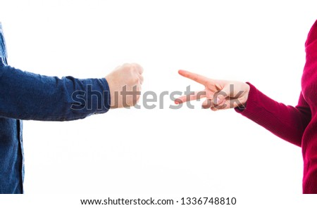Close up of man and woman hands playing rock paper and scissors game, showing different sign isolated over white background. Identify who won, business competition and rivalry concept, gender conflict #1336748810