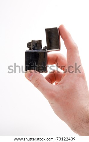 Close-up of  man hand holding a lighter over white