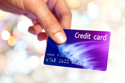 Close-up of man hand holding plastic credit card
