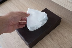 close up of man hand is grab a tissue paper from the tissue box
