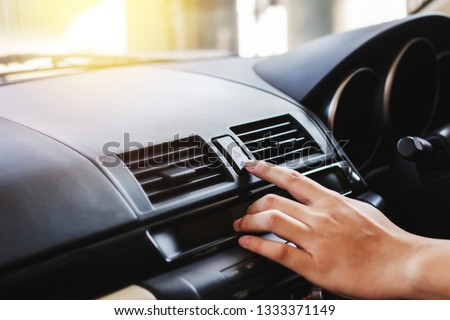close up of man hand presses the emergency stop button in the car