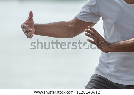 Shutterstock puzzlepix close up of man hands doing tai chi or tai ji traditional chinese martial arts m4hsunfo