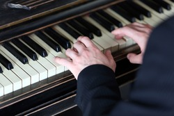 Close up of man hands piano playing