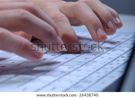 Close up of man hands typing on laptop keyboard #26438740