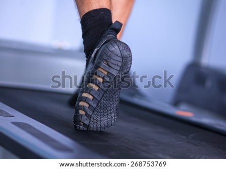 Close-up of man legs in sneakers on treadmill  #268753769