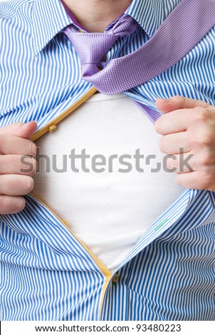 Close-up of man opening his shirt to reveal blank white shirt like superman