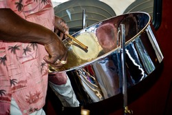 close up of man playing a steel drum